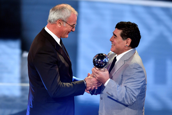 Leicester City's Italian manager Claudio Ranieri (L) is presentend with The Best FIFA Men's Coach of 2016 Award by former Argentine football player Diego Maradona during The Best FIFA Football Awards ceremony, on January 9, 2017 in Zurich. / AFP PHOTO / Fabrice COFFRINI