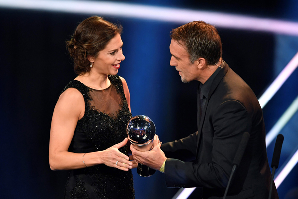 Houston Dash and US midfielder Carli Lloyd is presented with The Best FIFA Women's Player of 2016 Award by former Argentine footballer Gabriel Batistuta during The Best FIFA Football Awards ceremony, on January 9, 2017 in Zurich. / AFP PHOTO / Fabrice COFFRINI