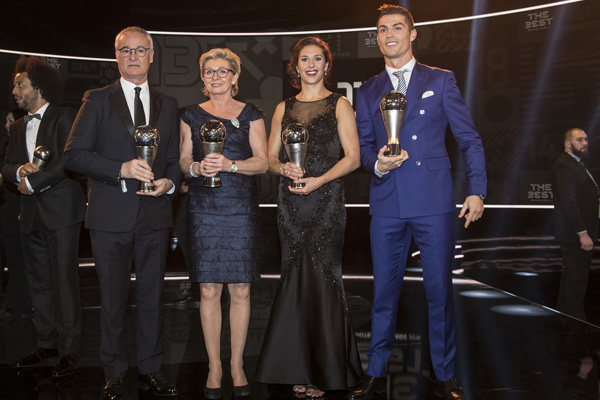 Claudio Ranieri of Italy, coach of Leicester City FC, former German women's national soccer team head coach Silvia Neid, United States' Carli Lloyd and Real Madrid's Cristiano Ronaldo, from left, pose with their trophies during the FIFA Awards 2016 gala at the Swiss TV studio in Zurich, Switzerland, Monday, Jan. 9, 2017. (Ennio Leanza/Keystone via AP)