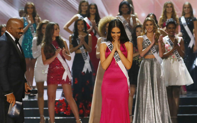 Chalita Suansane of Thailand greets the crowd the traditional Thai way after making it to the top 13 in the Miss Universe 2016 competition Monday, Jan. 30, 2017, at the Mall of Asia in suburban Pasay city? south of Manila, Philippines. Iris Mittenaere of France was crowned the Miss Universe. (AP Photo/Bullit Marquez)