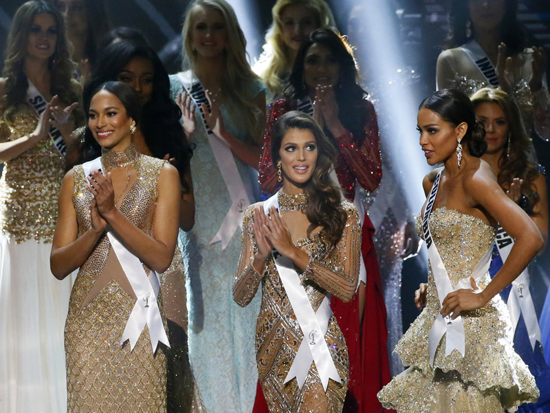 Andrea Tovar of Colombia, right, is applauded by fellow Miss Universe contestants shortly after being proclaimed 1st runner-up in the grand coronation Monday, Jan. 30, 2017, at the Mall of Asia in suburban Pasay city, south of Manila, Philippines. Iris Mittenaere of France, center, was crowned the Miss Universe 2016 while Raquel Pelissier of Haiti, left, was the runner-up. (AP Photo/Bullit Marquez)