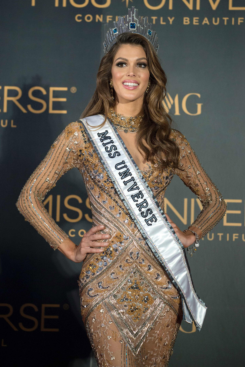 The new Miss Universe Iris Mittenaere of France poses for photographers during a press conference after being crowned the winner at the Miss Universe pageant at the Mall of Asia Arena in Manila on January 30, 2017. France was crowned Miss Universe on January 30 in a glitzy spectacle free of last year's dramatic mix-up but with a dash of political controversy as finalists touched on migration and other hot-button global issues. / AFP PHOTO / NOEL CELIS