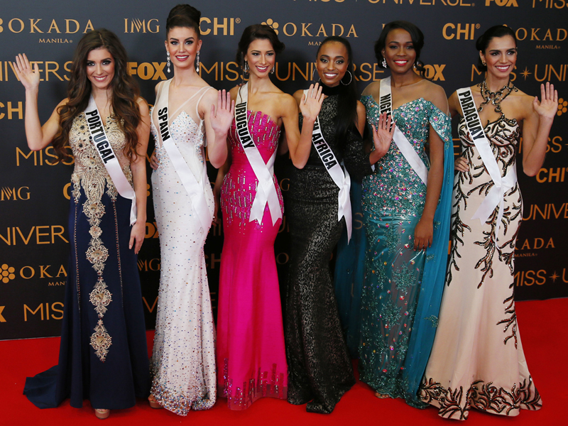 Miss Universe contestants pose on the red carpet on the eve of their coronation Sunday, Jan. 29, 2017, at the Mall of Asia in suburban Pasay city south of Manila, Philippines. Eighty-six conestants are vying for the title to succeed Pia Wurtzbach from the Philippines. From left, Flavia Brito of Portugal, Noelia Freire of Spain, Magdalena Cohendent of Uruguay, Ntandoyen Kunene of South Africa, Unoako Anyadike of Nigeria and Andrea Melgarejo of Paraguay.(AP Photo/Bullit Marquez)