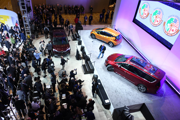 (170109) -- DETROIT, Jan. 9, 2017 (Xinhua) -- Honda Ridgeline(L), the Chevrolet Bolt(C) and Chrysler Pacifica are presented during a press preview of the 2017 North American International Auto Show (NAIAS) in Detroit, the United States, Jan. 9, 2017. The Chevrolet Bolt EV won Car of the Year, and the Honda Ridgeline became Truck of the Year in the North American International Auto Show (NAIAS) that opened here Monday. (Xinhua/Yin Bogu)