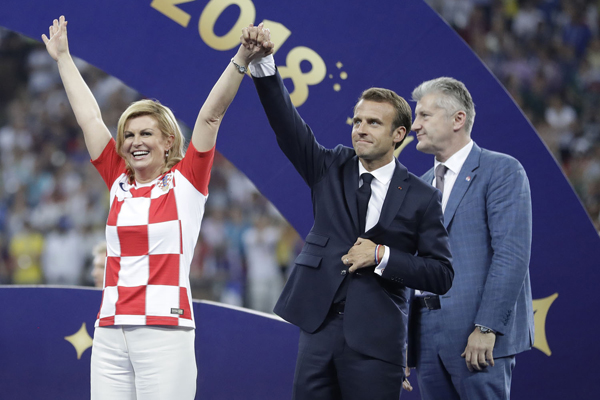 French President Emmanuel Macron and Croatian President Kolinda Grabar-Kitarovic arrive for the presentation after the final match between France and Croatia at the 2018 soccer World Cup in the Luzhniki Stadium in Moscow, Russia, Sunday, July 15, 2018. France won the final 4-2. (AP Photo/Matthias Schrader)