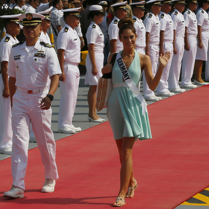 Miss Universe contestant Johanna Acs of Germany waves as she walks to the yacht Happy Life to join other contestants in a cruise to a beach resort in Batangas province, south of Manila, Thursday, Jan. 19, 2017 at the Philippine Navy headquarters in Manila, Philippines. Eighty-six candidates from around the world are vying for the title to succeed Pia Wurtzbach from the Philippines. The competition takes place on Jan. 30. (AP Photo/Bullit Marquez)