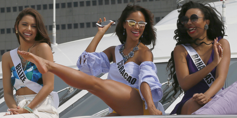 Miss Universe contestants, from left, Rebecca Rath of Belize, Chanelle de Lau of Curacao and Cherell Williamson of Bahamas pose for a photo aboard the yacht Happy Life prior to cruising to a beach resort in Batangas province Thursday, Jan. 19, 2017 at the Philippine Navy headquarters in Manila, Philippines. Eighty-six candidates from around the world are vying for the title to succeed Pia Wurtzbach from the Philippines. The competition takes place on Jan. 30. (AP Photo/Bullit Marquez)