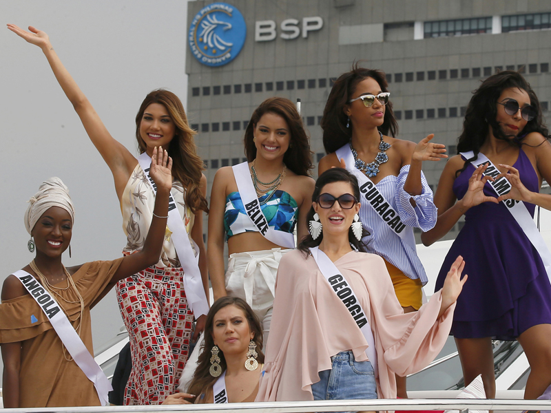 Miss Universe contestants pose from the deck of the yacht Happy Life prior to cruising to a beach resort in Batangas province, south of Manila, Thursday, Jan. 19, 2017 at the Philippine Navy headquarters in Manila, Philippines. Eighty-six candidates from around the world are vying for the title to succeed Pia Wurtzbach from the Philippines. The competition takes place on Jan. 30. They are, from left front row, Luisa Baptista of Angola, Teodora Dan of Romania and Nuka Karalashvili of Georgia. Back row from left, Keity Drennan of Panama, Rebecca Rath of Belize, Chanelle de Lau of Curacao and Cherell Williamson of Bahamas. (AP Photo/Bullit Marquez)