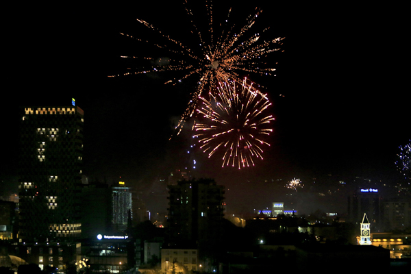 Fireworks explode over Nene Tereza Square to celebrate the New Year's Eve in Tirana, early Sunday, Jan. 1, 2017. (AP Photo/Hektor Pustina)