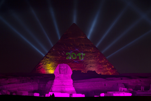 Lights illuminate the historical site of Giza Pyramids and Sphinx to celebrate the New Year in Egypt, Sunday, Jan. 1, 2017. (AP Photo/Amr Nabil)