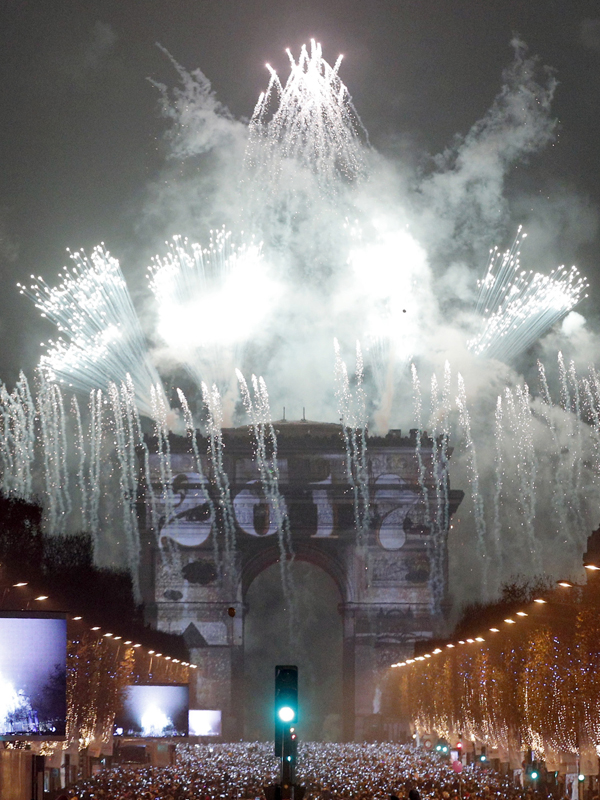 The 2017 appears during a firework over the Arc de Triomphe as part of the New Year celebrations on the Champs Elysees, in Paris, France, Sunday, Jan.1, 2017. (AP Photo/Christophe Ena)