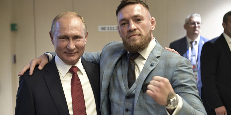 Russian President Vladimir Putin, left, and Ultimate fighting star Conor McGregor pose for a photo during the final match between France and Croatia at the 2018 soccer World Cup in the Luzhniki Stadium in Moscow, Russia, Sunday, July 15, 2018. (Alexei Nikolsky, Sputnik, Kremlin Pool Photo via AP)