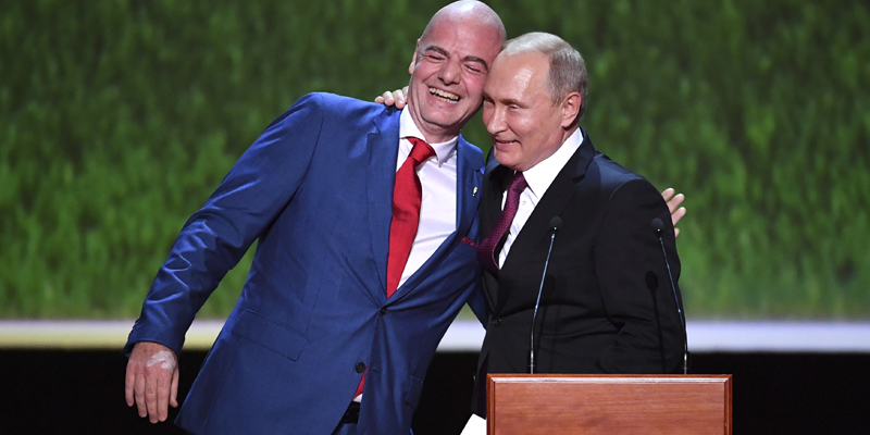 FIFA President Gianni Infantino, right, and Russian President Vladimir Putin embrace each other as they attend the gala-concert dedicated to the closing of FIFA Soccer World Cup at the Bolshoi Theater in Moscow, Russia, Saturday, July 14, 2018. (Yuri Kadobnov/Pool Photo via AP)