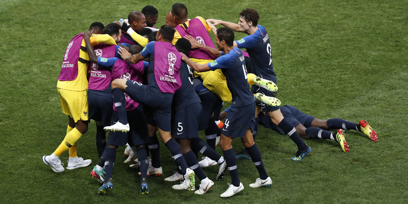 France players celebrate after Kylian Mbappe scored their side's fourth goal during the final match between France and Croatia at the 2018 soccer World Cup in the Luzhniki Stadium in Moscow, Russia, Sunday, July 15, 2018. (AP Photo/Rebecca Blackwell)