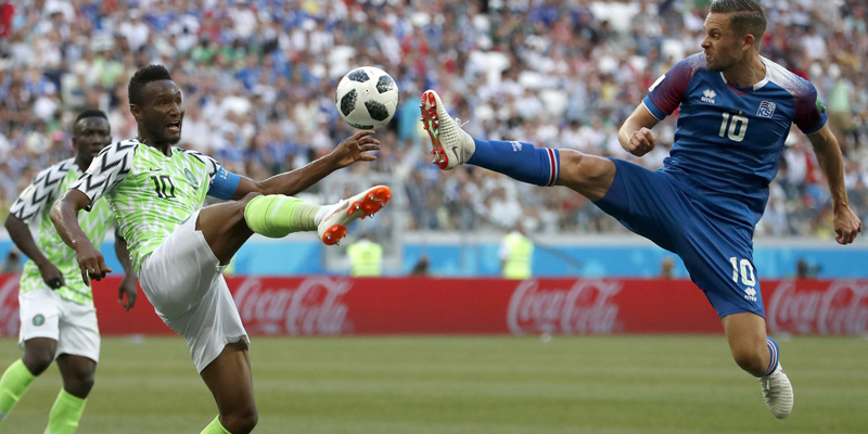 FILE - In this Friday, June 22, 2018 file photo Nigeria's John Obi Mikel, left, and Iceland's Gylfi Sigurdsson compete for the ball during the group D match between Nigeria and Iceland at the 2018 soccer World Cup in the Volgograd Arena in Volgograd, Russia. (AP Photo/Darko Vojinovic, File)