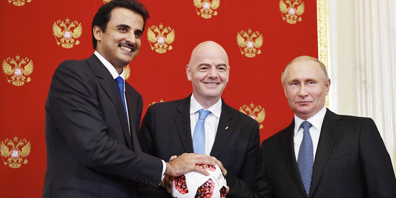 Russian President Vladimir Putin, right, FIFA President Gianni Infantino, center, and the Emir of Qatar Sheikh Tamim bin Hamad al-Thani pose for a a photo during their meeting in the Kremlin in Moscow, Russia, Sunday, July 15, 2018. (Yuri Kadobnov/Pool Photo via AP)